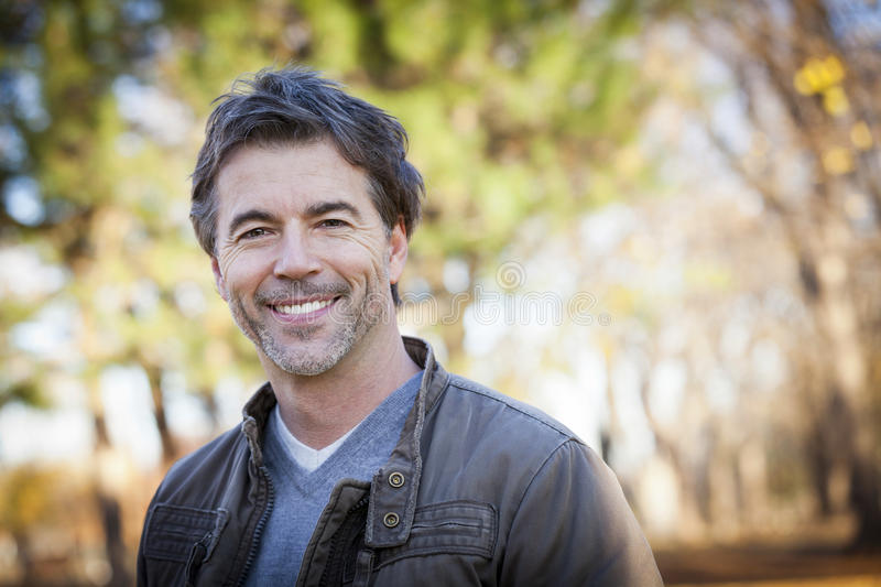 Handsome Mature Happy Man Smiling At The Camera stock photography