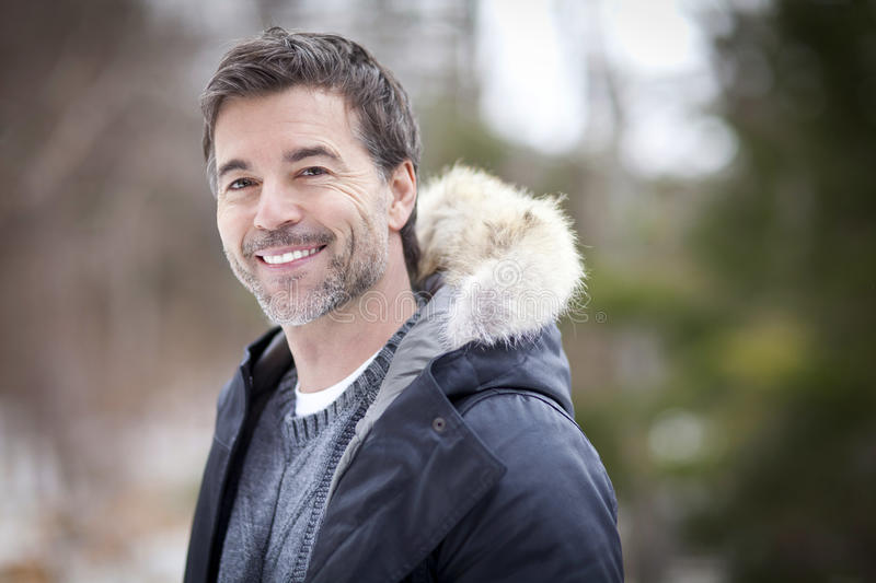 Handsome Mature Happy Man Smiling At The Camera. stock image