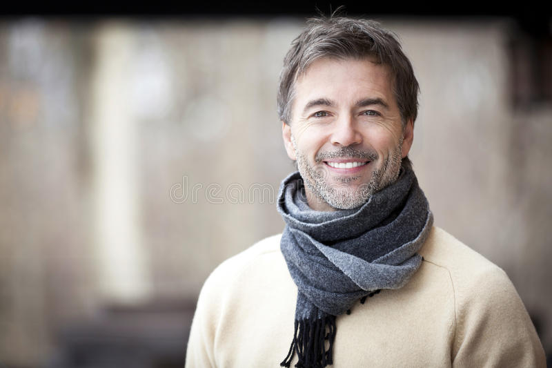 Handsome Mature Happy Man Smiling At The Camera. stock photography
