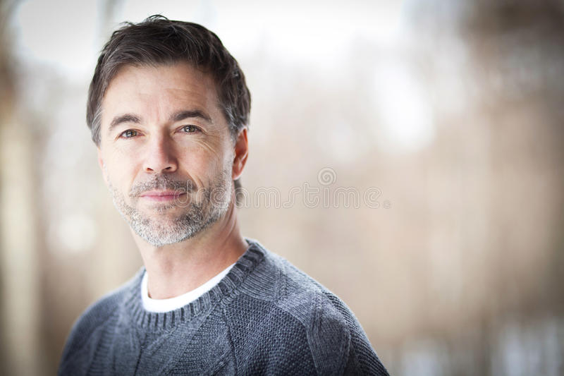 Handsome Mature Happy Man Smiling At The Camera. royalty free stock images
