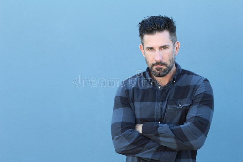 Handsome mature man crossing his arms with copy space stock images