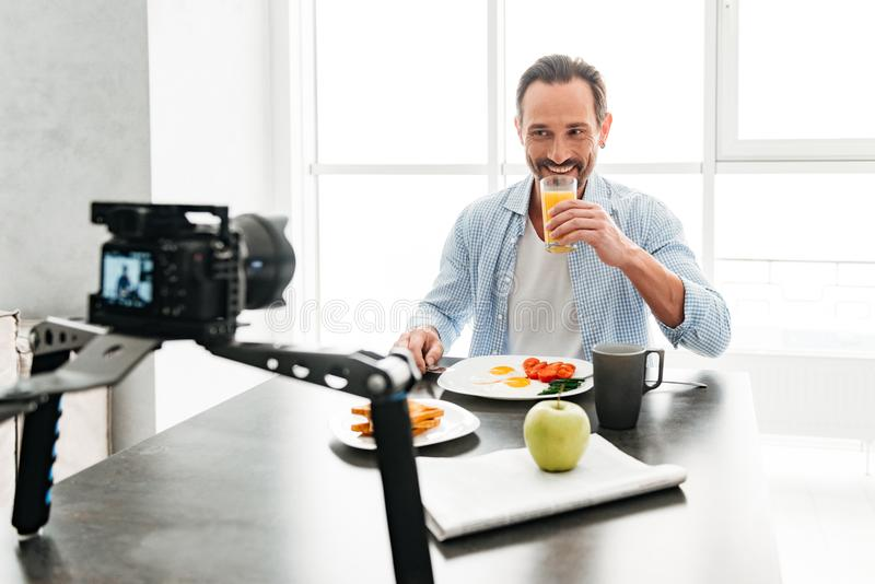 Handsome mature man recording video food blog royalty free stock image