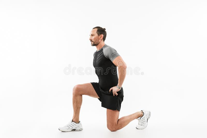 Handsome mature sportsman make exercises royalty free stock photo