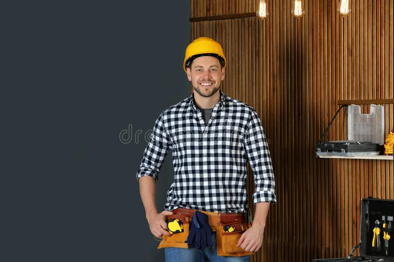 Handsome mature working man in hard hat . Home repair royalty free stock photography