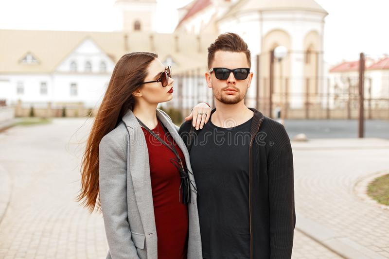 Handsome man with a beautiful woman in fashionable clothes stock photo