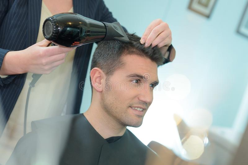 Handsome man in hairdressing saloon royalty free stock photo