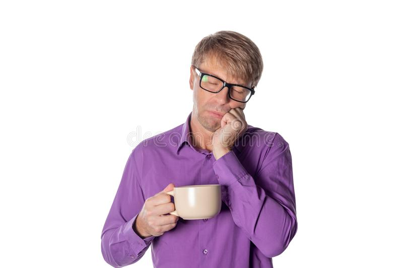 Handsome middle age man with cup of coffee isolated on white background stock photo