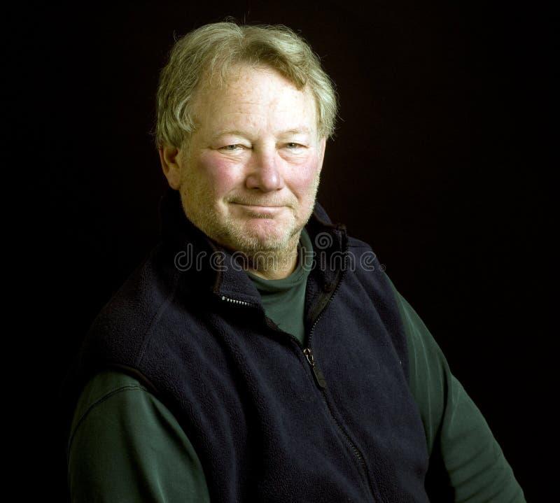 Handsome middle age senior studio portrait stock photos