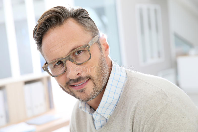 Handsome middle aged man at the office royalty free stock photos