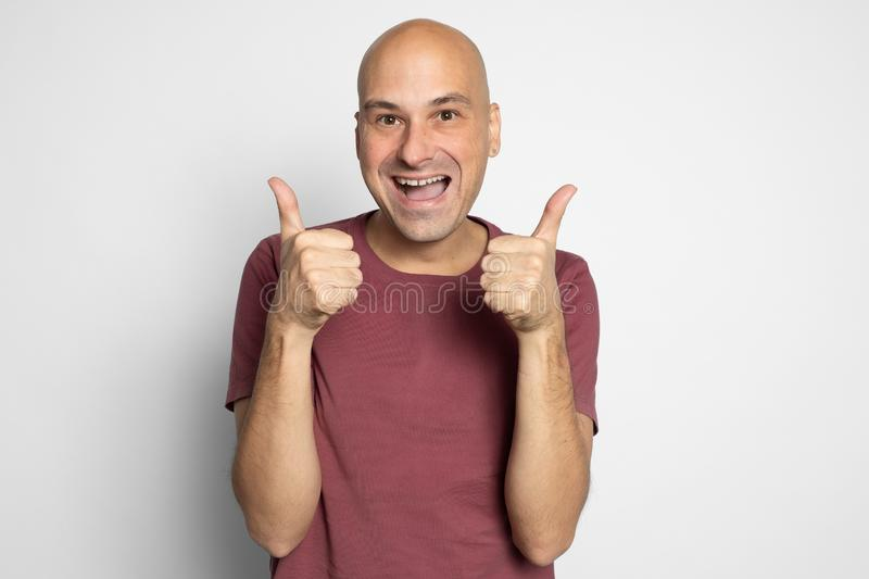 Handsome middle-aged man showing thumbs up stock photography