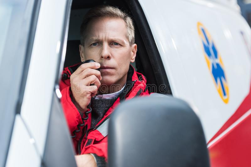 handsome middle aged paramedic talking royalty free stock image