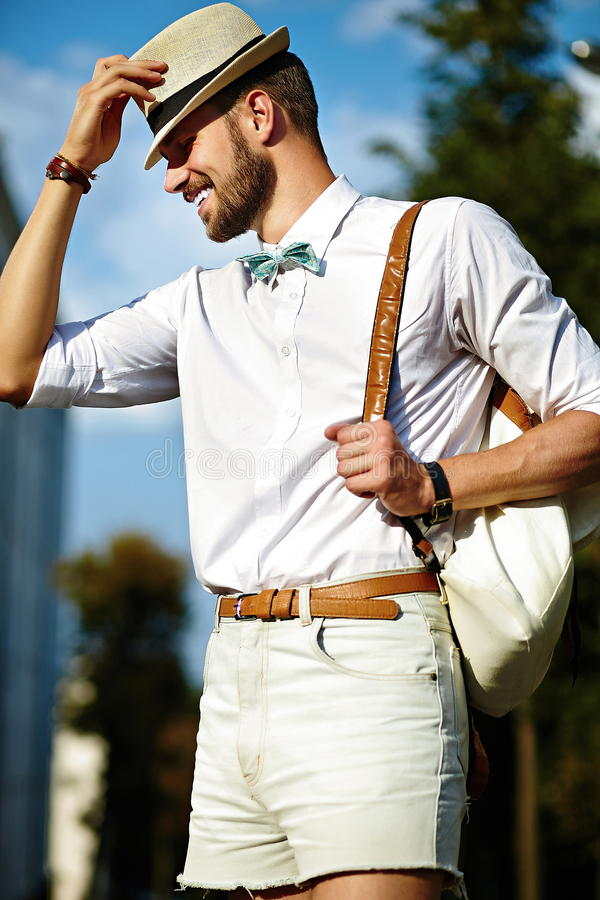Handsome model man in casual cloth with hat royalty free stock image