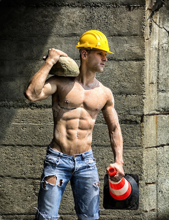 Handsome, muscular construction worker shirtless outdoor royalty free stock photography