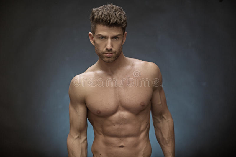 Handsome muscular guy with great hairstyle royalty free stock photography