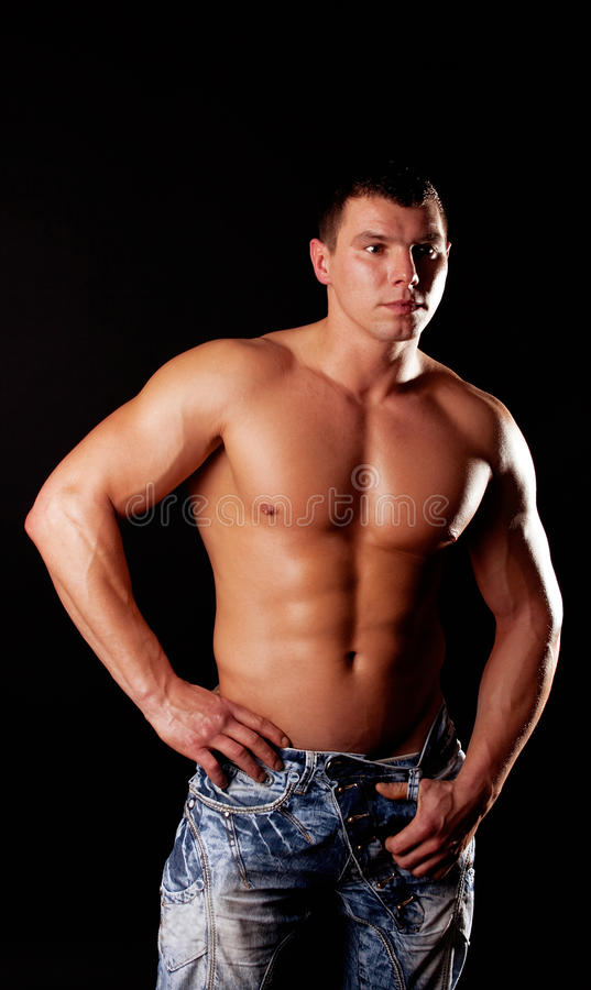 Handsome muscular guy posing royalty free stock photo