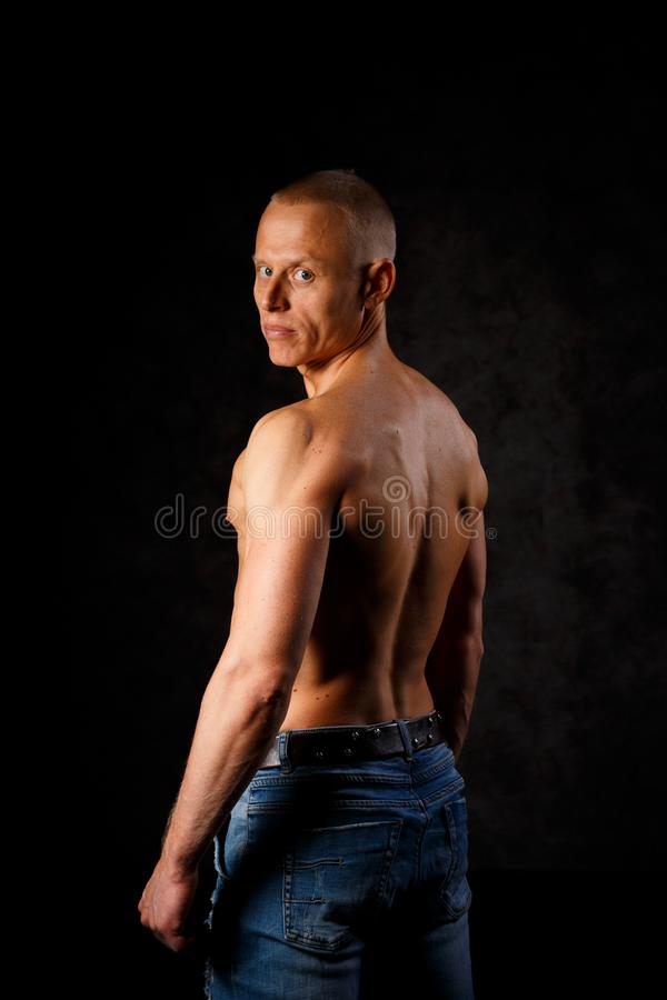Handsome and muscular man in dark background royalty free stock photos