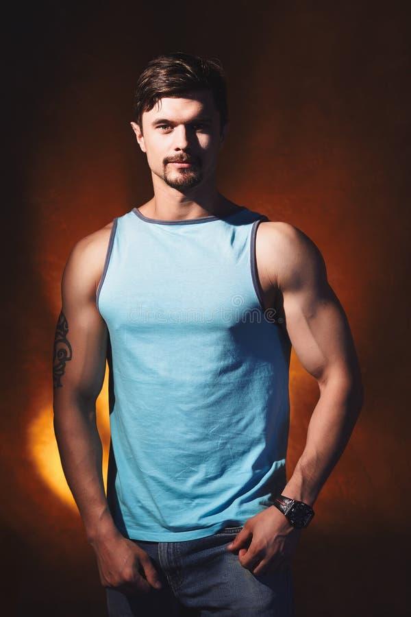 Handsome muscular man posing in studio. stock photo