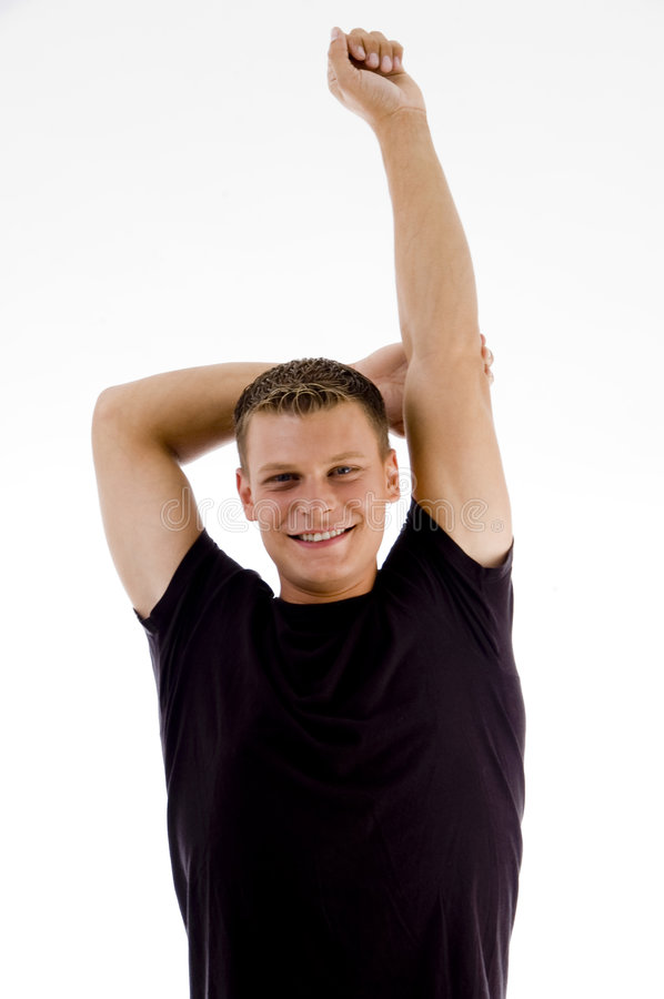 Handsome muscular man stretching his arms royalty free stock photos