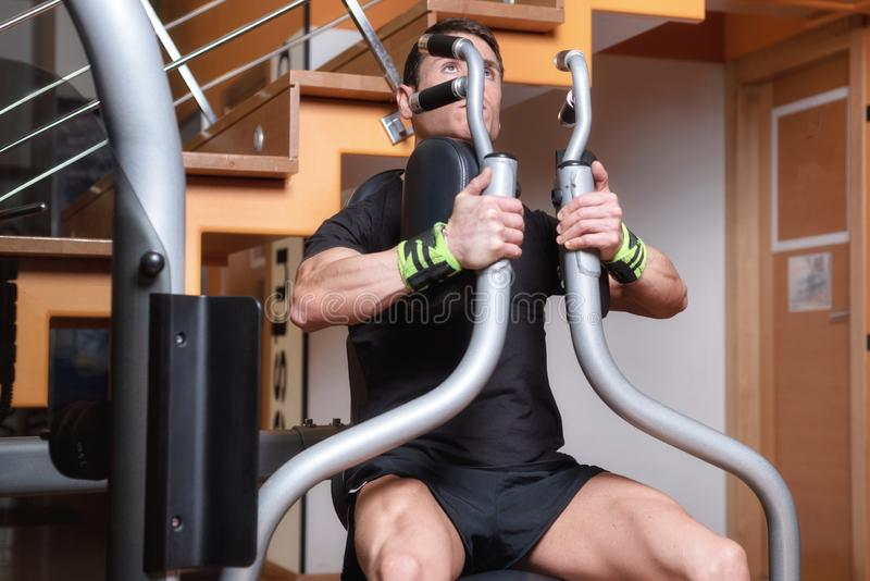 Handsome muscular man working out hard at gym. Training Chest exercises. Chest workouts. stock images