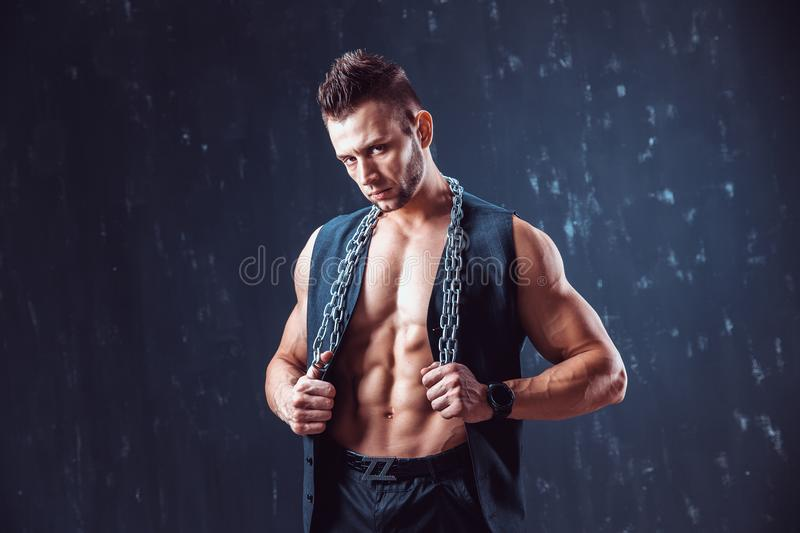 Stylish shirtless man in waistcoat royalty free stock images