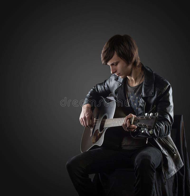 Handsome musician playing guitar royalty free stock images