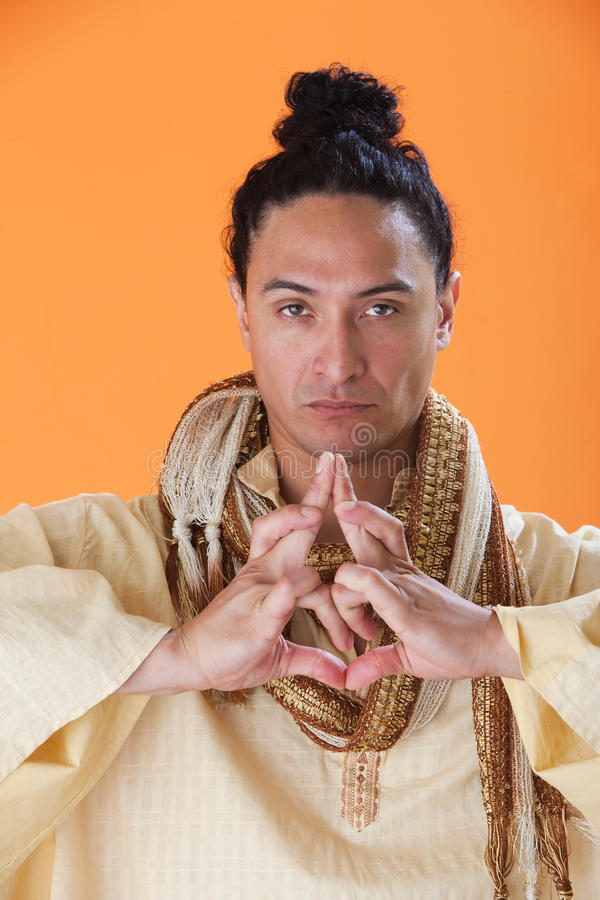 Handsome New Age Guru. Making a Strange Symbol with his hands royalty free stock photos
