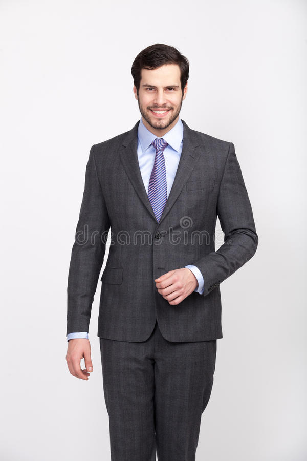 Handsome office business man with beard dressed in elegant suit, stock photos