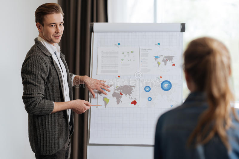 Handsome office worker showing a presentation stock image