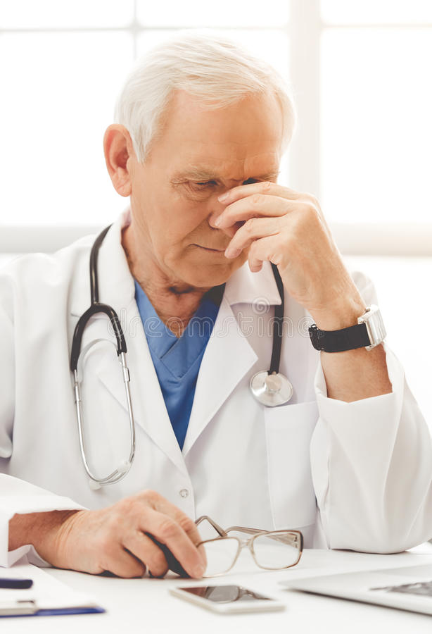 Handsome old doctor royalty free stock photos