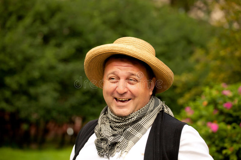 Handsome overweight man smiling and relaxing outdoor stock photo