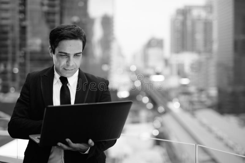 Handsome Persian businessman against view of the city royalty free stock images