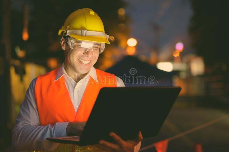 Handsome Persian man construction worker at the construction site at night. Portrait of handsome Persian man construction worker at the construction site royalty free stock photo