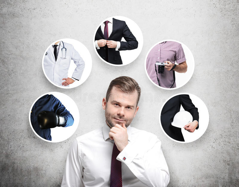 A handsome person in a formal shirt is thinking about different professions. stock photo