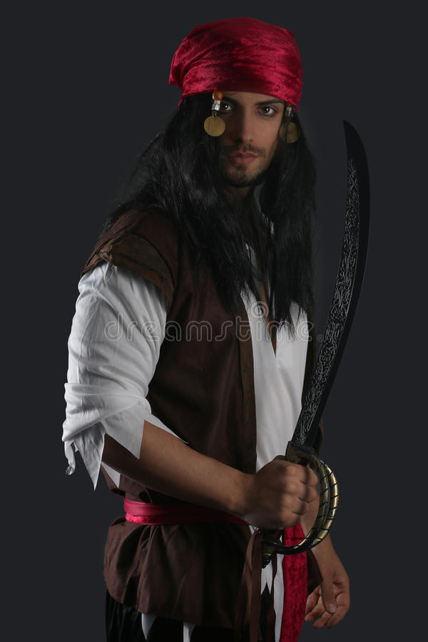 Handsome pirate holding a sword royalty free stock photo