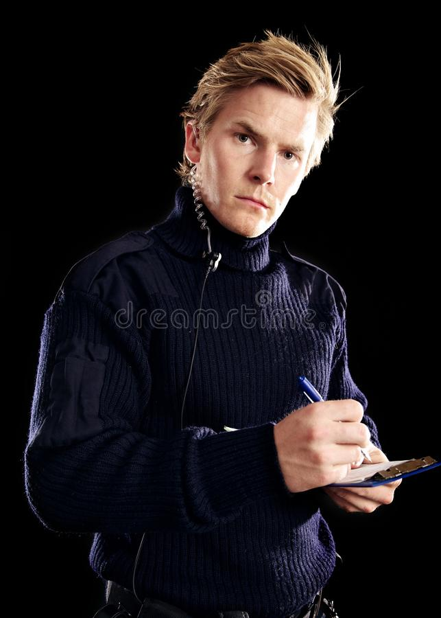 Download Handsome Police On Duty Writing Something Stock Photo - Image: 28935790