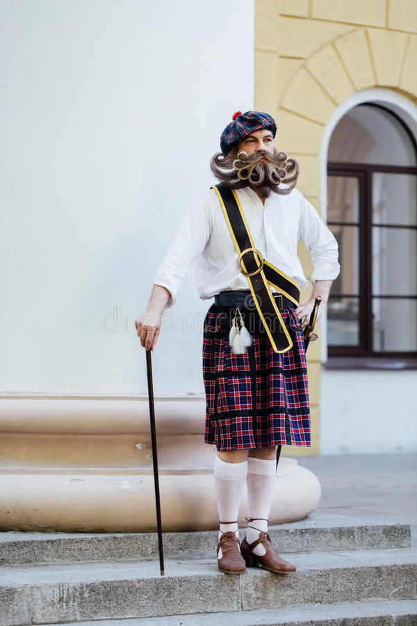 Handsome portrait of a brave Scot with a amazing beard and mustache curls in the Hungarian style. royalty free stock photography