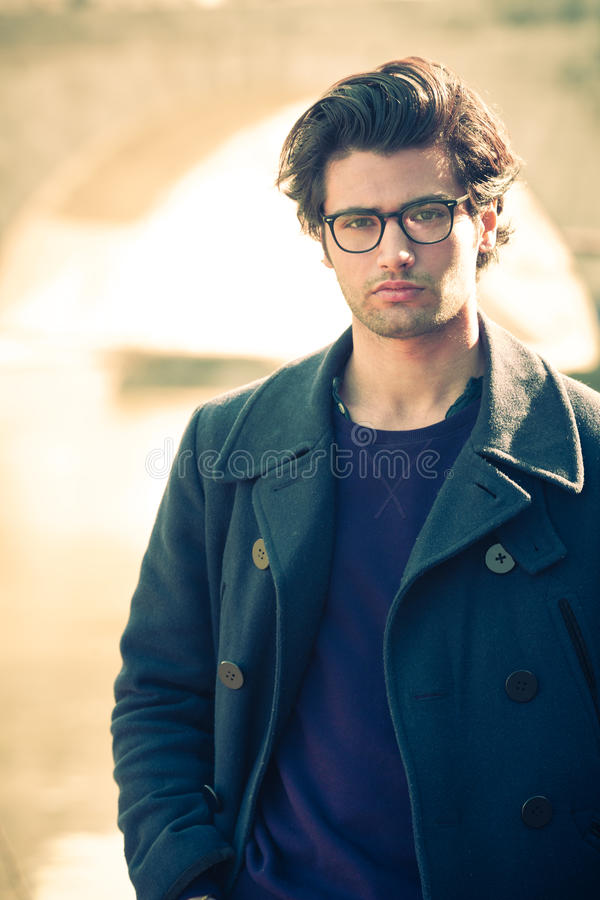 Handsome portrait man outdoor. Model hair and clothing style. stock photo