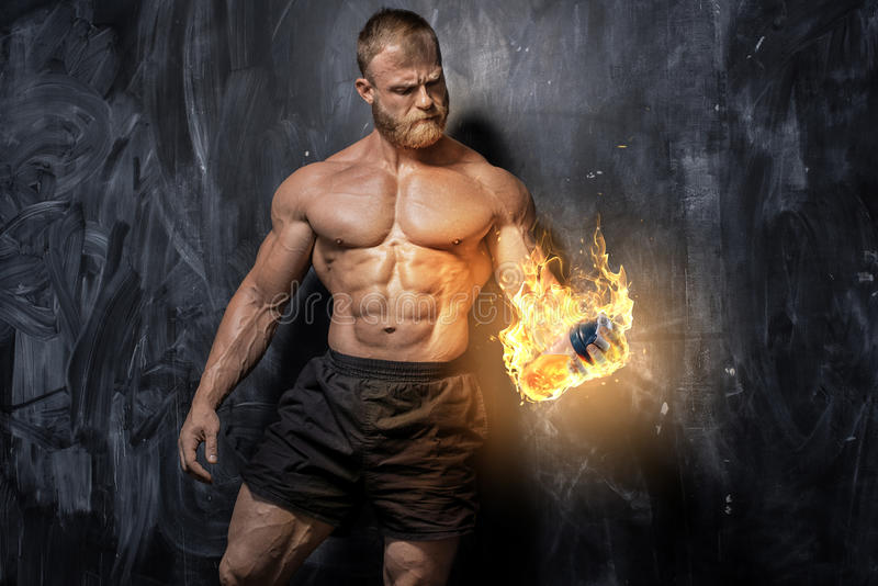 Handsome power athletic man bodybuilder. stock image