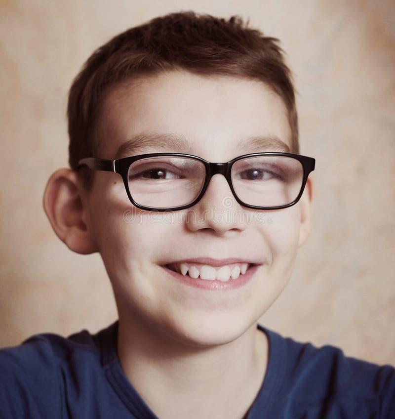 Preteen boy with correction myopia glasses stock photography