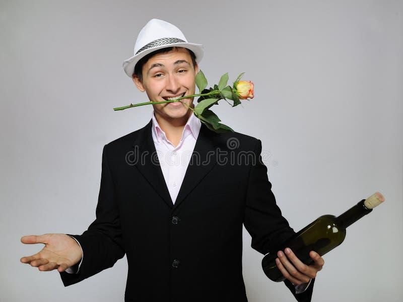 Download Handsome Romantic Man With Rose Flower,vine Bottle Stock Image - Image: 16924933
