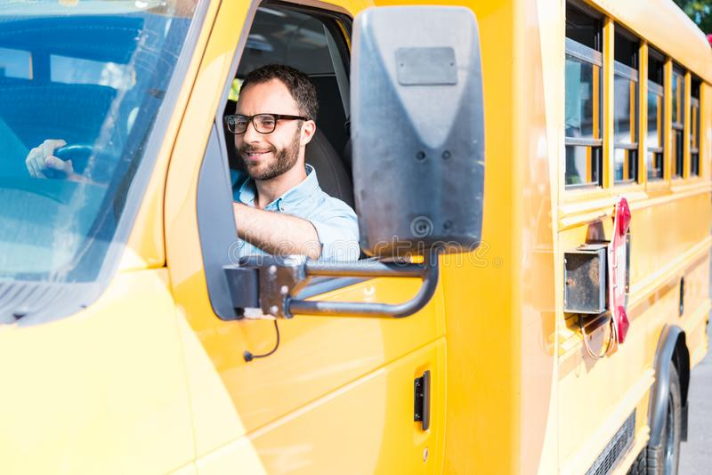 handsome school bus driver smiling stock image
