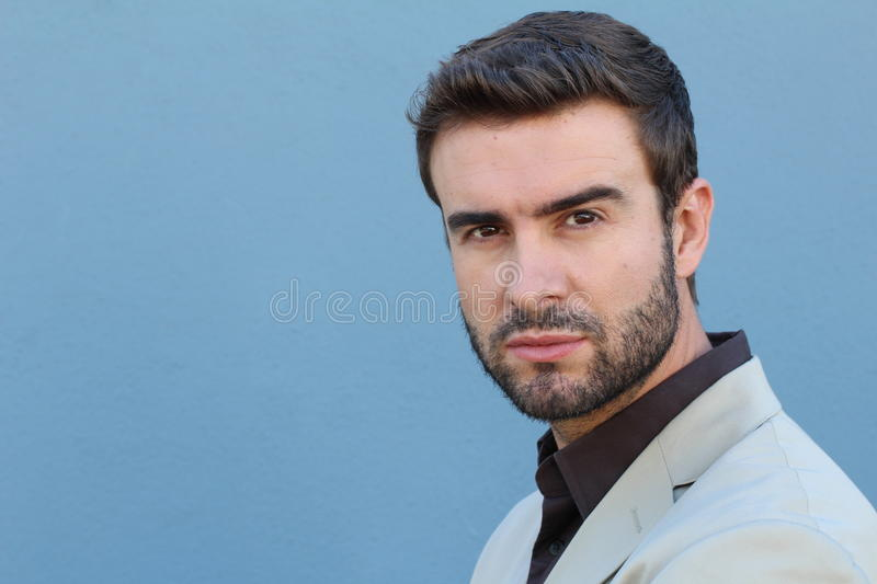 Handsome seductive man flirting and looking at camera with space for copy or text stock photo