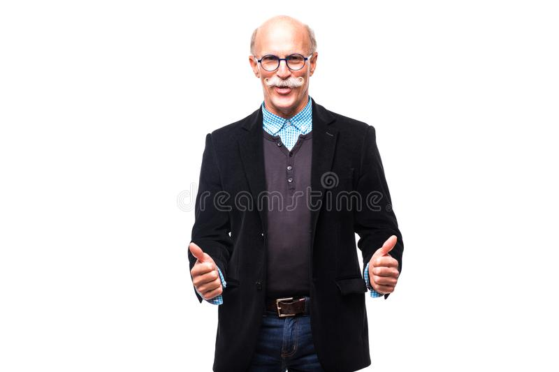 Handsome senior business man showing thumbs up gesture on white royalty free stock photography