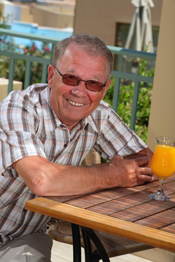 Handsome senior male. Relaxing outdoors royalty free stock photography