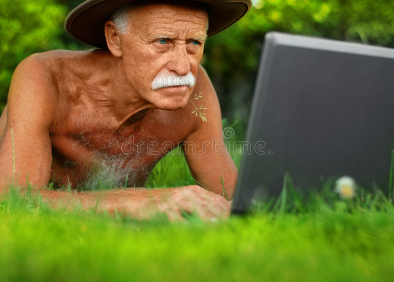 Handsome senior man. With computer