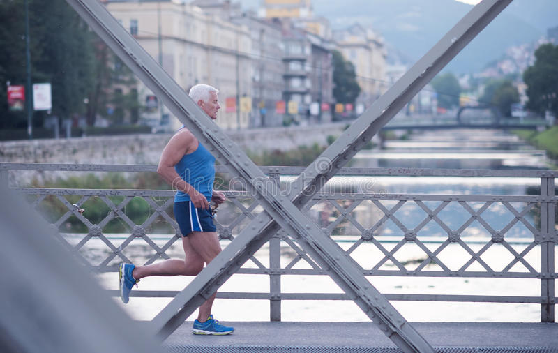 Download Handsome Senior Man  Jogging Stock Photo - Image: 71987765