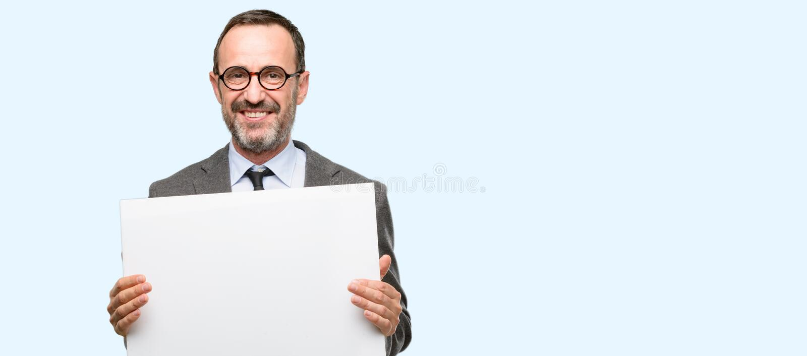 Handsome senior man over blue background royalty free stock image