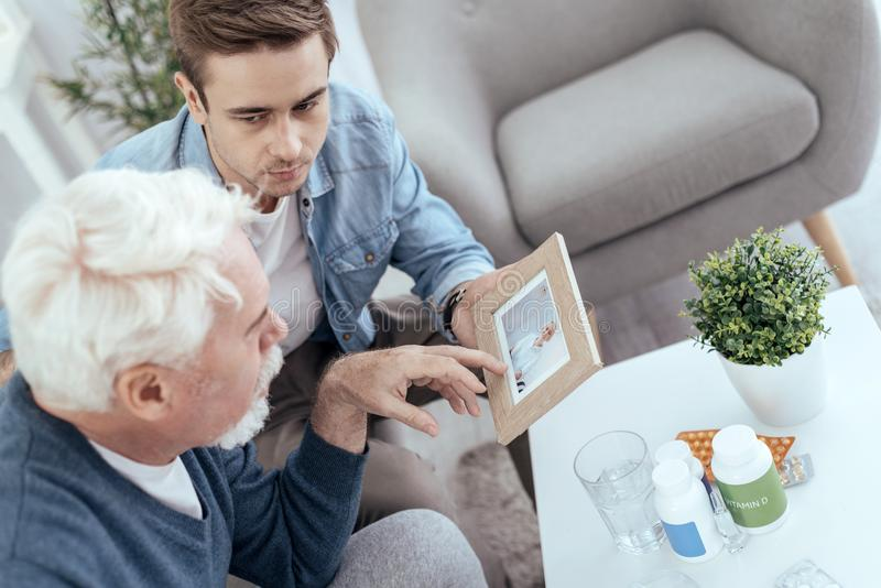 Handsome senior man recollecting past stock image
