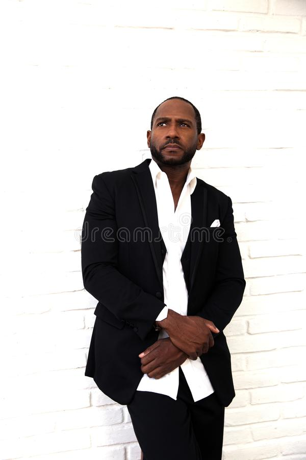 Handsome serious african american business man in classy black suit stock photos