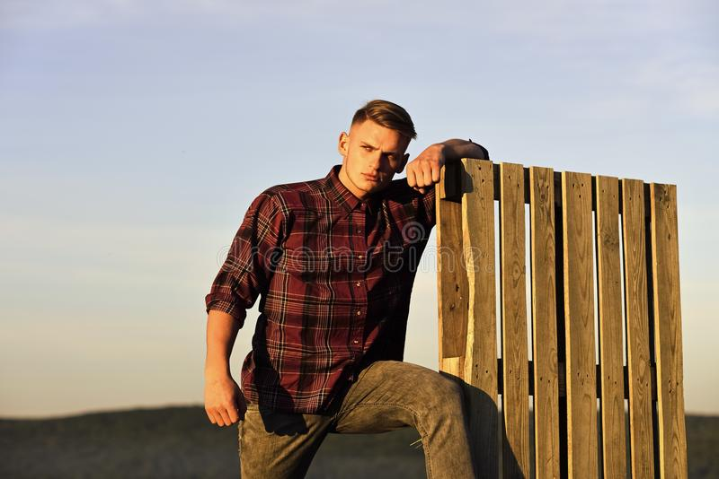 Handsome male model relaxed on blue sky background royalty free stock photos